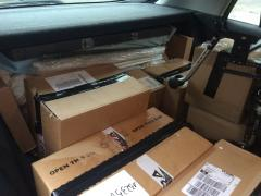 Car full of cardboard boxes.